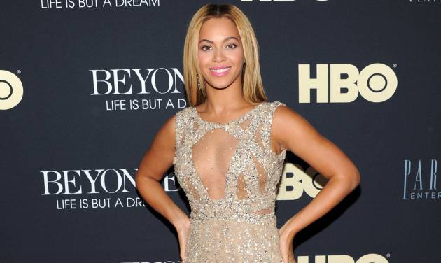 """FILE - In this Feb. 12, 2013 photo, Beyonce Knowles attends the premiere of """"Beyonce: Life Is But A Dream"""" at the Ziegfeld Theatre, in New York. Knowles is among 11 celebrities and government officials whose private financial information appears to have been posted online by a site that began garnering attention on Monday, March 11, 2013. (Photo by Evan Agostini/Invision/AP, File)"""