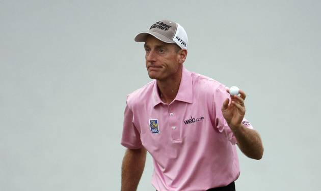 Jim Furyk shows his ball after making par on the 18th hole during the final round of The Players championship golf tournament at TPC Sawgrass, Sunday, May 11, 2014, in Ponte Vedra Beach, Fla. (AP Photo/Lynne Sladky)