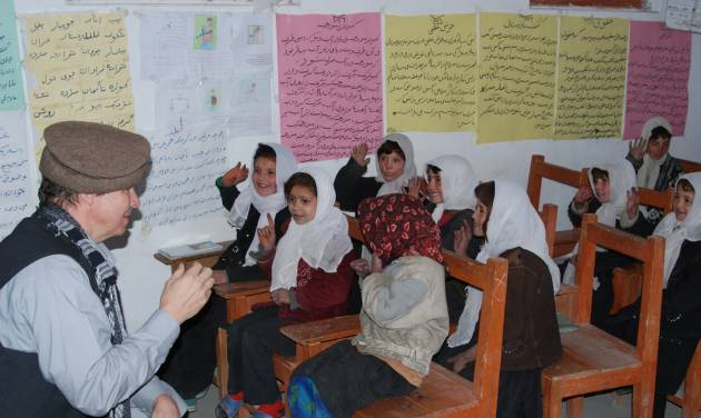 """In this November 2011 photo provided by the Central Asia Institute, the group's co-founder, Greg Mortenson, left, practices counting with first-graders in one of CAI's four schools in Zebak District, Badakhshan Province, Afghanistan. A federal judge on Monday, April 30, 2012 dismissed a lawsuit against author Mortenson, calling claims """"flimsy and speculative"""" that the humanitarian and his publisher lied in his best-selling """"Three Cups of Tea"""" and """"Stones Into Schools"""" to boost book sales. (AP Photo/Central Asia Institute, Sarfraz Khan)"""