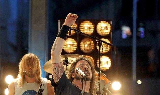 """FILE- Dave Grohl and the Foo Fighters performs during the 54th annual Grammy Awards in this file photo dated Sunday, Feb. 12, 2012, in Los Angeles. On Tuesday Aug. 28, 2012, music industry online magazine NME says the Foo Fighters have played their """"last show for a long time,"""" but an official familiar with the group says more concerts are scheduled, as speculation was ignited by Grohl's closing comments at the end of Sunday's Reading Festival in England.(AP Photo/Chris Pizzello, File)"""
