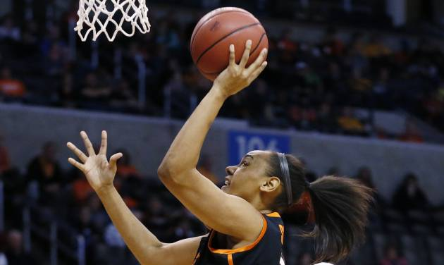 Oklahoma State center Kendra Suttles, center, shoots in front of Baylor forward Nina Davis (13) and point Sune Agbuke (22) in the first half of an NCAA college basketball game in the semifinals of the Big 12 Conference women's college tournament in Oklahoma City, Sunday, March 9, 2014. Baylor won 65-61. (AP Photo/Sue Ogrocki)