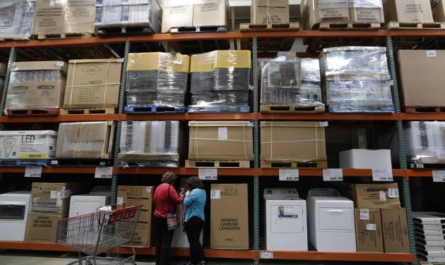 In this June 4, 2014 photo, shoppers look at washers and dryers at a Costco in Plano, Texas. The Commerce Department releases business inventories for April on Thursday, June 12, 2014. (AP Photo/LM Otero)