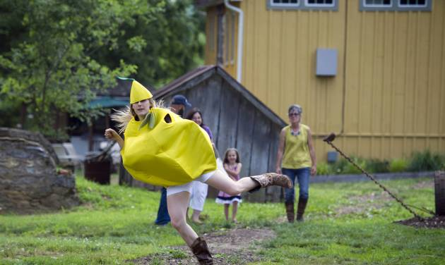 This photo taken June 26, 2014 shows Bloomery Plantation Distillery employee Allison Manderino, 28, transforming into The Lemon Dancer to entertain visitors to the distillery in Charles Town, W.Va. With its sweet fruit-flavored liqueurs, a working farm and eccentric cast of characters— including a dancing lemon — Bloomery Plantation Distillery has attracted tourists from every U.S. state and countries as far away as Laos and Iceland. The West Virginia mini-distillery is part of a growing agriculture tourism trend that advocates say can help revive struggling rural economies. Ag tourism refers to working farm enterprises geared to visitors, encompassing farm stands, pumpkin patches, barn dances, zip-line rides, pick-your-own berries, corn mazes and even weddings. (AP Photo/Cliff Owen)