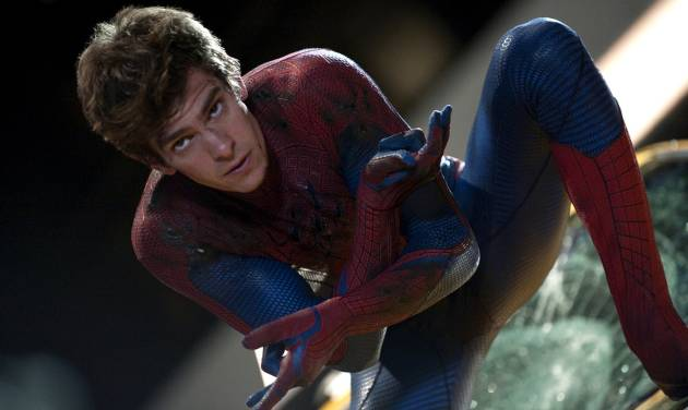 """In this film image released by Sony Pictures, Andrew Garfield is shown in a scene from """"The Amazing Spider-Man, set for release on July 3, 2012. """"The Amazing Spider-Man"""" pulled in $7.5 million from its debut screenings just after midnight Tuesday, July 3. (AP Photo/Columbia - Sony Pictures, Jaimie Trueblood)"""