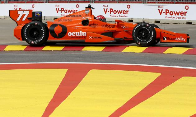 Simon Pagenaud, of France, drives through Turn 2 during a practice session for the IndyCar Grand Prix of Houston auto race Friday, June 27, 2014, in Houston. (AP Photo/David J. Phillip)
