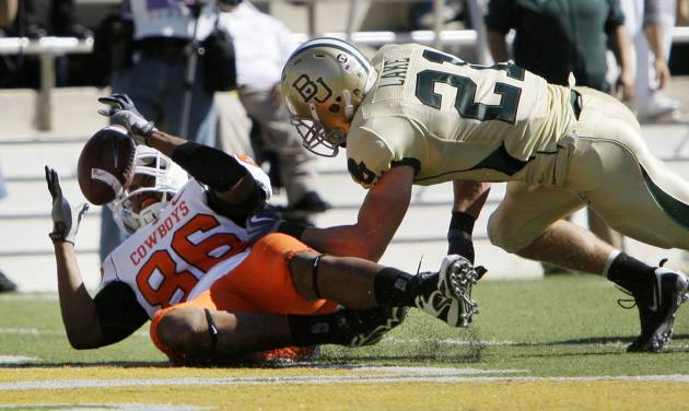 Oklahoma State tight end Wilson Youman (86) reaches out to control a pass for a touchdown as Baylor safety Jordan Lake (21) defends during the first half of an NCAA college football game, Saturday, Oct. 24, 2009, in Waco, Texas. (AP Photo/Tony Gutierrez)