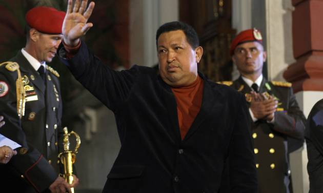 Venezuela's President Hugo Chavez waves after an impromptu news conference with the foreign press at Miraflores palace in Caracas, Venezuela, Saturday, Oct. 6, 2012. Chavez is running for re-election against opposition candidate Henrique Capriles in Sunday's presidential election. (AP Photo/Ramon Espinosa)