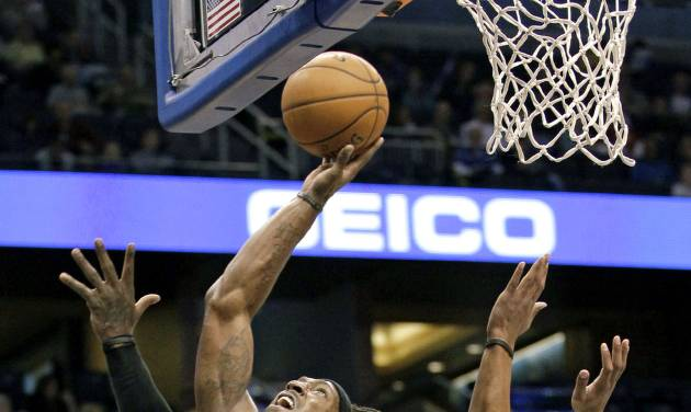 Brooklyn Nets' Gerald Wallace (45) takes a shot in front of Orlando Magic's Arron Afflalo (4) during the first half of an NBA basketball game, Friday Nov. 30, 2012, in Orlando, Fla. (AP Photo/John Raoux)