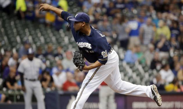 Milwaukee Brewers starting pitcher Wily Peralta throws during the first inning of a baseball game against the Colorado Rockies on Thursday, June 26, 2014, in Milwaukee. (AP Photo/Morry Gash)