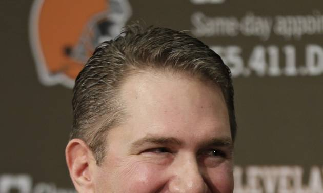 New Cleveland Browns head coach Rob Chudzinski laughs at a joke by owner Jimmy Haslam during a news conferencing introducing Chudzinski at the NFL football team's practice facility in Berea, Ohio Friday, Jan. 11, 2013. (AP Photo/Mark Duncan)