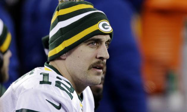 Green Bay Packers' Aaron Rodgers watches his team play during the second half of an NFL football game against the New York Giants, Sunday, Nov. 25, 2012, in East Rutherford, N.J. (AP Photo/Kathy Willens)