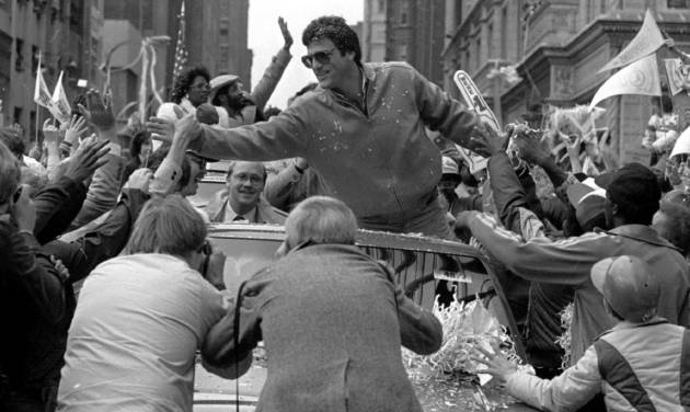 St. Louis Cardinals catcher Darrell Porter reaches out to shake hands with the crowd during a victory parade through downtown St. Louis on Oct. 21, 1982. Porter was named the NLCS and World Series Most Valuable Player. The Cardinals beat the Brewers in seven games in the Series.                     AP Photo