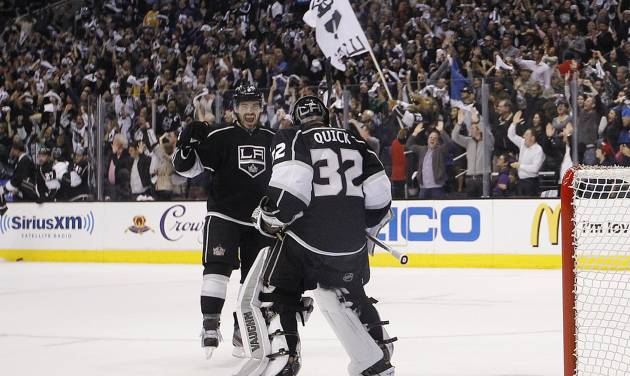 Los Angeles Kings' Drew Doughty, left, and goalie Jonathan Quick celebrate their team's 2-1 win against the St. Louis Blues in Game 6 of a first-round NHL hockey Stanley Cup playoff series in Los Angeles, Friday, May 10, 2013. (AP Photo/Jae C. Hong)