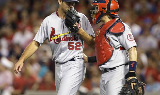 St. Louis Cardinals starting pitcher Michael Wacha (52) talks with catcher Yadier Molina in the fifth inning of a baseball game against the Cincinnati Reds, Tuesday, Sept. 3, 2013, in Cincinnati. (AP Photo/Al Behrman)