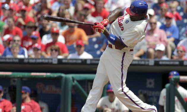 Philadelphia Phillies'  Ryan Howard hits a one run single against the Atlanta Braves in the first inning of the first game of a baseball double-header Saturday, June 28, 2014, in Philadelphia.  (AP Photo/H. Rumph Jr)