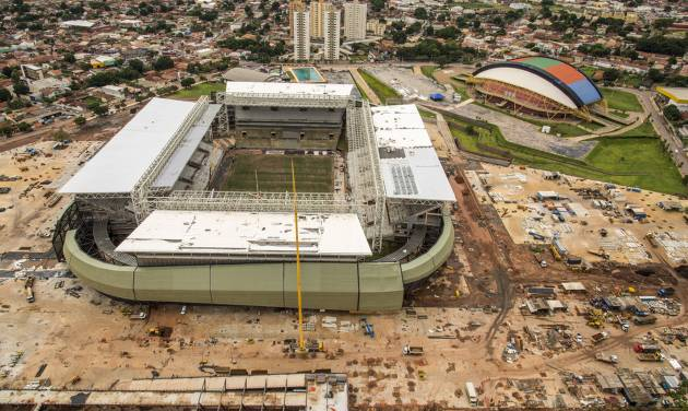 FILE - This Jan. 10, 2014 file photo, released by Portal da Copa, shows an aerial view of the Arena Pantanal in Cuiaba, Brazil. A worker at the World Cup stadium died Thursday, May 8, 2014 in an electrical accident, temporarily interrupting construction at Arena Pantanal, one of the most-delayed venues before the soccer tournament. (AP Photo/Portal da Copa, Jose Medeiros, File)