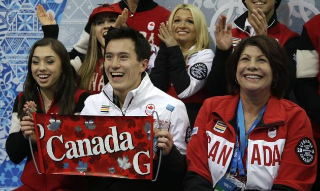 Patrick Chan of Canada, centre, and his team members wait for his results after he competed in the men's team short program figure skating competition at the Iceberg Skating Palace during the 2014 Winter Olympics, Thursday, Feb. 6, 2014, in Sochi, Russia. (AP Photo/Darron Cummings, Pool)