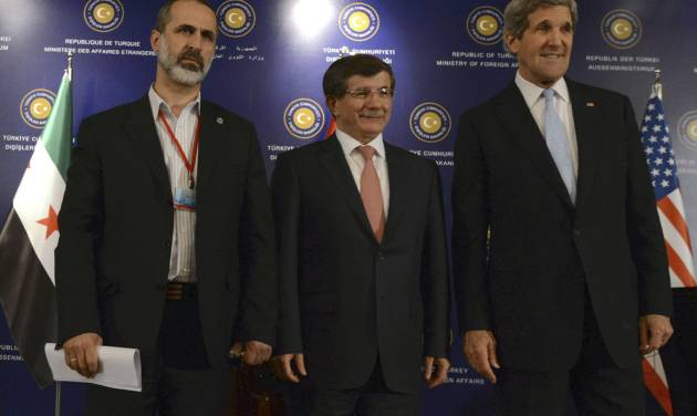 """U.S. Secretary of State John Kerry, right,  Turkish Foreign Minister Ahmet Davutoglu, center, and Syrian opposition leader Moaz al-Khatib pose for photos after a """"Friends of Syria"""" group meeting at the Adile Sultan Palace on Sunday, April 21, 2013, in Istanbul, Turkey. The United States said Sunday that it will double its non-lethal assistance to Syria's opposition as the rebels' top supporters vowed to enhance and expand their backing of the two-year battle to oust President Bashar Assad's regime.  (AP Photo)"""