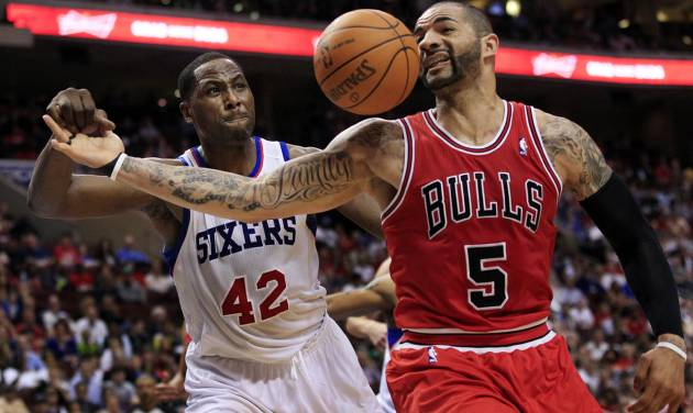 Chicago Bulls' Carlos Boozer (5) loses the ball as he is defended by Philadelphia 76ers' Elton Brand (42) during the first quarter of Game 3 in an NBA basketball first-round playoff series in Philadelphia, Friday, May 4, 2012. (AP Photo/Mel Evans)