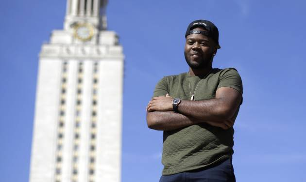In this March 5, 2013 photo, University of Texas senior Bradley Poole, 21, poses for a photo on the campus in Austin, Texas. Poole, an advertising major, became president of the school's Black Student Alliance, seeking camaraderie after noticing he often was the only African-American in his classes. In two pivotal legal cases, one on affirmative action and another on voting rights, a divided U.S. Supreme Court may be poised in the coming weeks to rule that racism is largely a relic of America's past. The question is apt as the nation nears a demographic tipping point, when non-whites become the country's majority for the first time. (AP Photo/Eric Gay)
