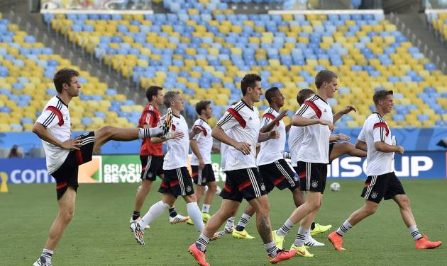 Germany's team exercises during an official training session one day before the World Cup quarterfinal soccer match between Germany and France at the Maracana Stadium in Rio de Janeiro, Brazil, Thursday, July 3, 2014. (AP Photo/Martin Meissner)
