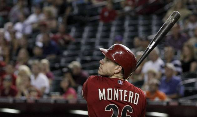 Arizona Diamondbacks' Miguel Montero watches his RBI double against the San Diego Padres in the fourth inning of a baseball game Wednesday, Sept. 19, 2012, in Phoenix.(AP Photo/Ross D. Franklin)