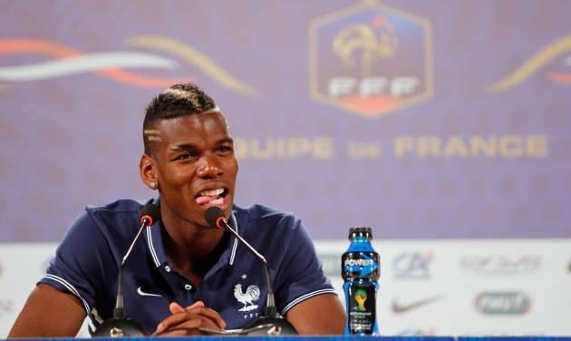 France's Paul Pogba answers journalists' questions during a press conference at the Teatro Pedro II, in Ribeirao Preto, Brazil, Tuesday, June 10, 2014. France will face Ecuador, Switzerland and Honduras in group E of the World Cup. (AP Photo/David Vincent)