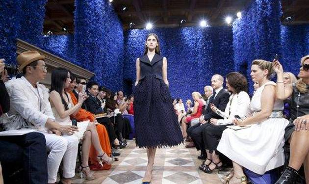 A model wears a creation by fashion designer Ralf Simons for Dior's Haute Couture Fall-Winter 2013 collection presented in Paris, Monday July 2, 2012. (AP Photo/Jacques Brinon)