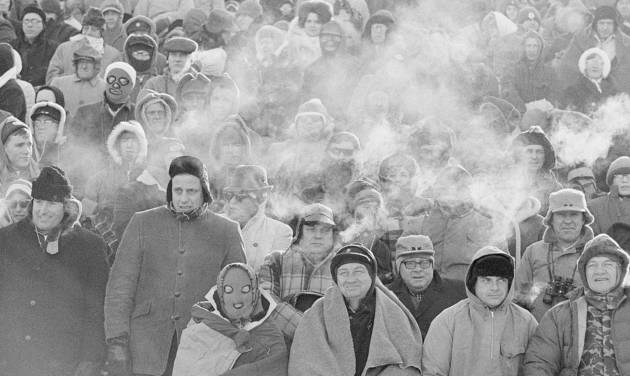 FILE - In this Dec. 31, 1967 file photo, fans watch the Green Bay Packers play the Dallas Cowboys in the NFL Championship game in Green Bay, Wisc. Comparisons to the legendary 1967 Ice Bowl are inevitable when the mercury dips below zero at Lambeau Field. But even if temperatures sink to minus 13 Sunday, Jan. 5, 2014, at the 49ers-Packers playoff game, modern technology will ensure fans are warmer than their predecessors.  (AP Photo/File)