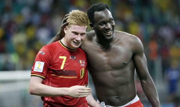 Belgium's  Kevin De Bruyne, left, and Romelu Lukaku, right, celebrate after the World Cup round of 16 soccer match between Belgium and the USA at the Arena Fonte Nova in Salvador, Brazil, Tuesday, July 1, 2014. Belgium held on to beat US 2-1 in extra time.(AP Photo/Felipe Dana)