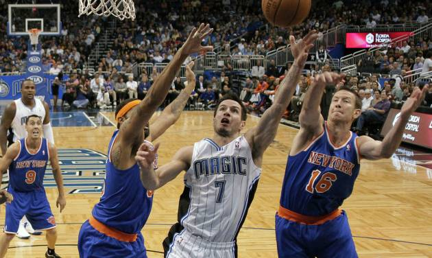 FILE - In this Nov. 13, 2012 file photo, Orlando Magic's J.J. Redick (7) goes up for a shot between New York Knicks' Steve Novak (16) and Rasheed Wallace, left, during the first half of an NBA basketball game in Orlando, Fla. A person familiar with the situation says the Orlando Magic have agreed to trade veteran shooting guard Redick, center Gustavo Ayon and reserve point guard Ish Smith to the Milwaukee Bucks in exchange for guards Doron Lamb and Beno Udrih, as well as forward Tobias Harris. The person spoke to The Associated Press Thursday, Feb. 21, 2013 on condition of anonymity because the deal was not officially complete. (AP Photo/John Raoux, FIle)
