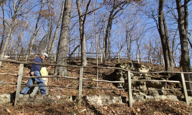 FILE-- In this Nov. 8, 2010 file photo, Paul and Sue Schramm, of Dyersville, Iowa, hike one of the trails at Effigy Mounds National Monument in Harpers Ferry, Iowa. Records show that National Park Service officials approved $3 million in illegal construction projects over a decade that damaged one of the nation's most sacred Indian burial sites. (AP Photo/The Des Moines Register, Justin Hayworth, File) MAGS OUT; TV OUT; NO SALES; MANDATORY CREDIT