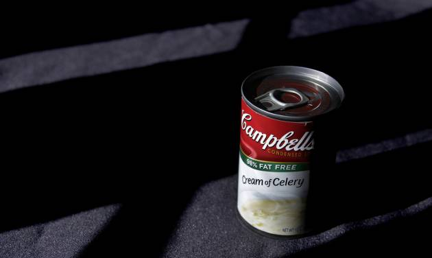 FILE-In this Wednesday, Aug. 31, 2011, file photo, light shines on a can of Campbell's soup in Moreland Hills, Ohio. Campbell Soup Co. announced Tuesday, Sept. 4, 2012, that net income rose 27 percent in its fiscal fourth quarter. The results beat analysts' expectations and the food maker gave fiscal 2013 revenue guidance above Wall Street's view. (AP Photo/Amy Sancetta, File)