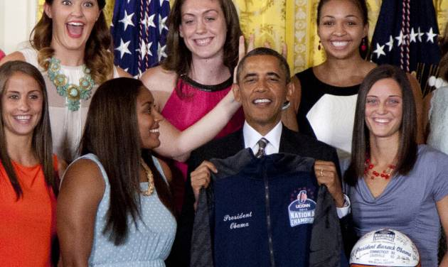 "FILE - In this July 31, 2013 file photo, University of Connecticut Huskies teammates Stefanie Dolson, top left, and Kiah Stokes, top right, give the 'bunny ears' to President Barack Obama as he poses for photo with the team to honor their 2013 NCAA Women's Basketball Championship win, during a ceremony in the East Room of the White House in Washington. Also seen top center Breanna Stewart, and from bottom left, Caroline Doty, Kaleena Mosqueda-Lewis and Kelly Faris. On Saturday, March 1, 2014, Dolson and fellow senior Bria Hartley will have their names added to the ""Huskies of Honor"" wall at Gampel Pavilion on the UConn campus in Storrs, Conn. (AP Photo/Carolyn Kaster, File)"
