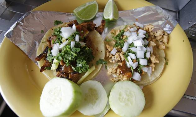 In this July 29, 2014, photo, a plate of Taco Al Pastor is displayed at Chunga's Mexican Grill, in Salt Lake City. The hunt for a taste of Mexico City brings diners near a highway overpass in a neighborhood known for tire shops and tacos. (AP Photo/Rick Bowmer)