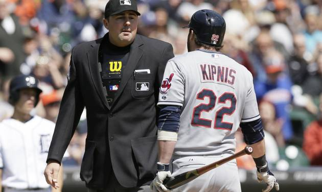 Homeplate umpire Lance Barrett talks to Cleveland Indians' Jason Kipnis after Kipnis argues his ejection after striking out during the third inning of a baseball game against the Detroit Tigers in Detroit, Thursday, April 17, 2014. (AP Photo/Carlos Osorio)