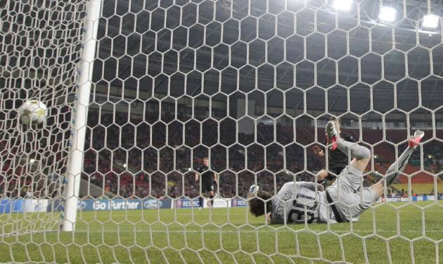 Spartak Moscow's goalkeeper Sergei Pesyakov fails to save a shot by Celtic's Giorgos Samaras, unseen, during their Champions League Group G soccer match at the Luzhniki stadium in Moscow, Russia, on Tuesday, Oct. 2, 2012. Celtic won 3-2. (AP Photo/Ivan Sekretarev)