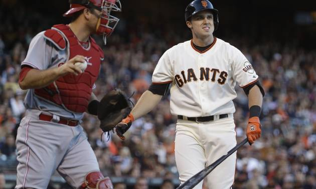 San Francisco Giants' Adam Duvall, right, reacts after striking out on a foul tip as Cincinnati Reds catcher Devin Mesoraco, left, looks on in the second inning of their baseball game Thursday, June 26, 2014, in San Francisco. Duvall was making his major league debut in the game. (AP Photo/Eric Risberg)