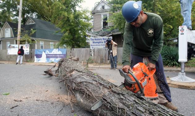 Friday morning, Oct. 12, 2012 the Soulsville USA community witnessed the first steps in the restoration of Memphis Slim's house, as Daniel Hernandez cuts a downed tree that was leaning on the structure in Memphis, Tenn. (AP Photo/The Commercial Appeal, Mike Maple)