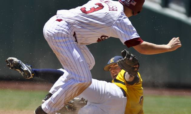 South Carolina's Tanner English, top, safely steals second base against Kent State shortstop Jimmy Rider during the sixth inning of an NCAA College World Series elimination baseball game in Omaha, Neb., Thursday, June 21, 2012. (AP Photo/Eric Francis)