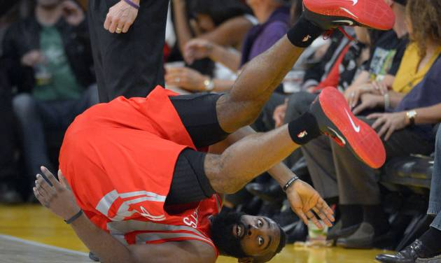 Houston Rockets guard James Harden rolls over after being fouled by Los Angeles Lakers guard Jodie Meeks during the first half of their NBA basketball game, Sunday, Nov. 18, 2012, in Los Angeles. (AP Photo/Mark J. Terrill)