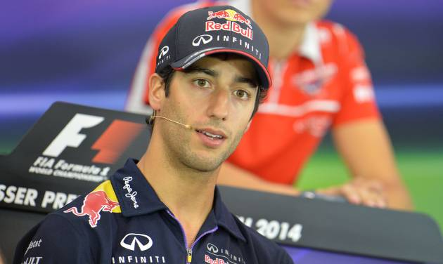 Red Bull driver Daniel Ricciardo of Australia listens to a question from a journalist during a press conference in Spielberg, Austrian province of Styria, Thursday, June 19, 2014. The Austria Formula One Grand Prix will be held here  on Sunday. (AP Photo/Kerstin Joensson)