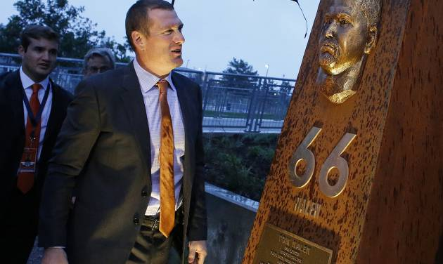 Former Denver Broncos center Tom Nalen looks at a newly unveiled pillar bearing his likeness at the opening ceremony for the Broncos Ring of Fame Plaza, at Mile High Stadium in Denver, Friday Sept. 27, 2013. Nalen is to be inducted into the Ring of Fame this weekend. (AP Photo/Brennan Linsley)