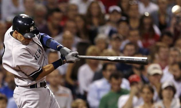 New York Yankees' Derek Jeter swings on an RBI single off Boston Red Sox pitcher Junichi Tazawa during the seventh inning of a baseball game, Thursday, Sept. 13, 2012, at Fenway Park in Boston. (AP Photo/Charles Krupa)