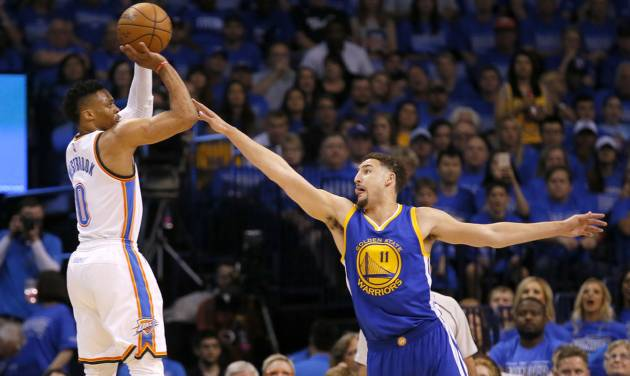 Oklahoma City\'s Russell Westbrook (0) shoots over Golden State\'s Klay Thompson (11) during Game 6...