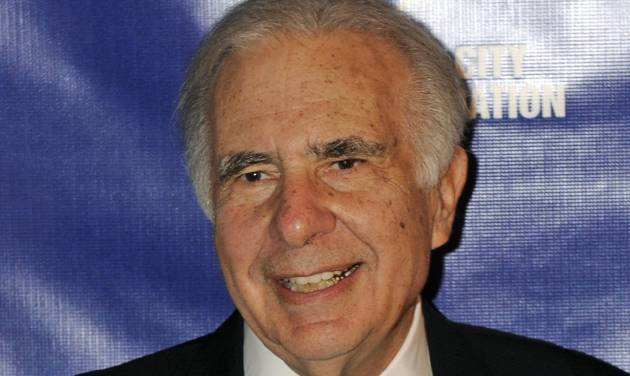 FILE - In this March 16, 2010 file photo, financier Carl Icahn poses for photos upon arriving for the 32nd annual New York City Police Foundation Gala in New York. Icahn is pressuring Apple to spend $150 billion buying back its own stock, a target that would more than double the amount that the company's board authorized in a previous attempt to placate frustrated shareholders. (AP Photo/Henny Ray Abrams, File)