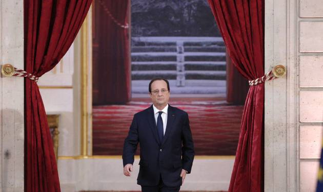 French President Francois Hollande arrives to deliver his speech at his  annual news conference, Tuesday, Jan.14, 2014 at the Elysee Palace in Paris. The French president's complex personal life ó and what it means to be the first lady in modern society ó may get a full airing as Hollande answers questions for the first time since a tabloid reported he was having an affair with an actress. (AP Photo/Christophe Ena)