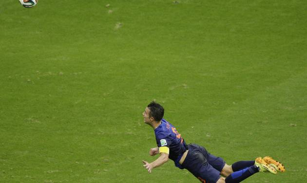 In this Friday, June 13, 2014 photo, Netherlands' Robin van Persie heads the ball to score during the group B World Cup soccer match between Spain and the Netherlands at the Arena Ponte Nova in Salvador, Brazil. The Dutchman's header that looped over a stranded Iker Casillas in the Spain goal was not only very special but historic. By taking his tally to 45 goals for his country, the Manchester United forward also became the first Dutch player to score in three consecutive World Cups. (AP Photo/Christophe Ena)
