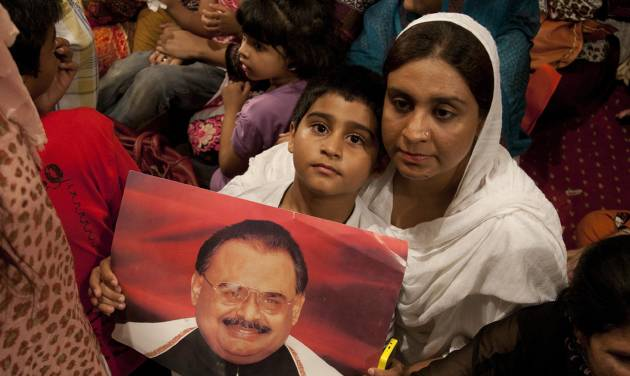 Supporters of the Muttahida Qaumi Movement, or MQM, one of Pakistan's major political parties, attend a sit in protest condemning the arrest in London of its leader, Altaf Hussain, in Islamabad, Pakistan, Wednesday, June 4, 2014. British police arrested one of Pakistan's most well-known and divisive politicians Tuesday on suspicion of money-laundering, sparking fears of violence in his power base of Karachi where businesses closed early and residents rushed home. (AP Photo/Shakil Adil)