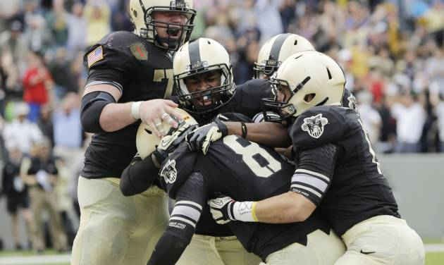 Army quarterback Trent Steelman (8) celebrates with teammates after scoring the game-winning touchdown against Boston College during the second half of an NCAA college football game Saturday, Oct. 6, 2012, in West Point, N.Y. Army won, 34-31. (AP Photo/Mike Groll)